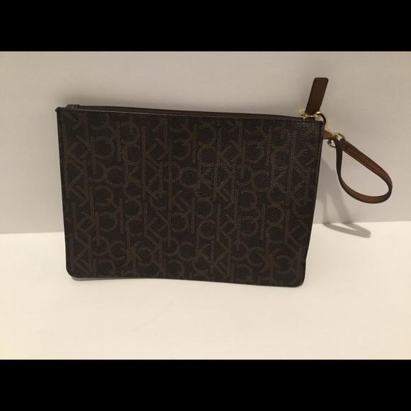 46b82ac6688 Calvin Klein Bags | Womens Pochette Monogram Brown | Poshmark